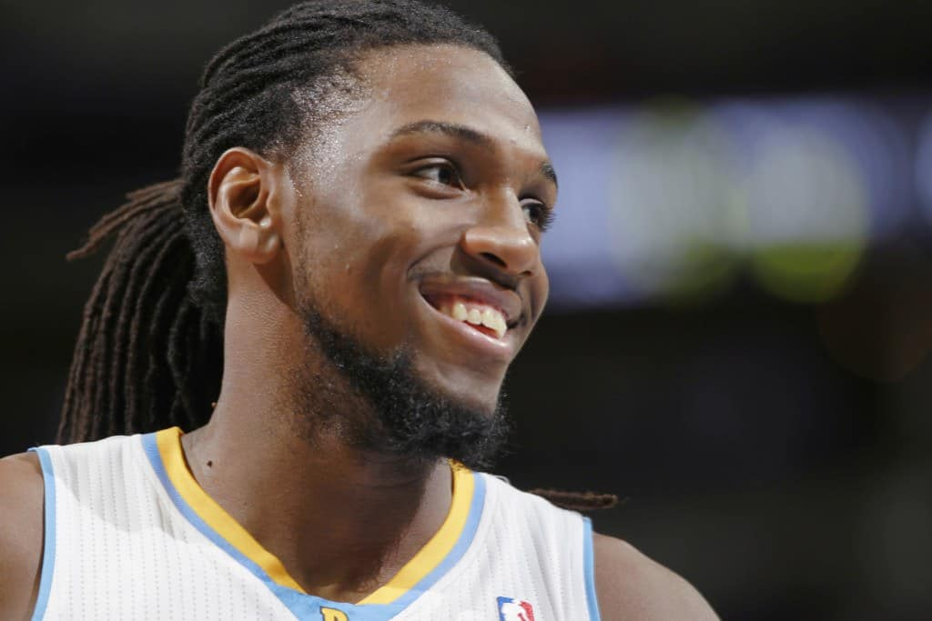 Denver Nuggets forward Kenneth Faried jokes with teammates as the Nuggets build a 30-point-lead over the Orlando Magic in the fourth quarter of the Nuggets' 120-94 victory in an NBA basketball game in Denver on Saturday, Jan. 11, 2014. (AP Photo/David Zalubowski)