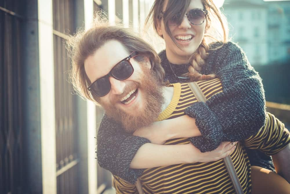 woman hugging bearded guy