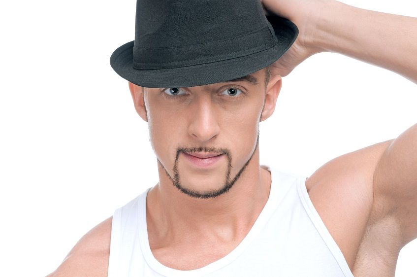 man with chinstrap beard wears hat