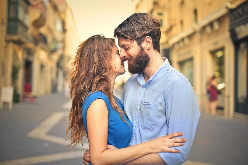 woman kissing guy with beard