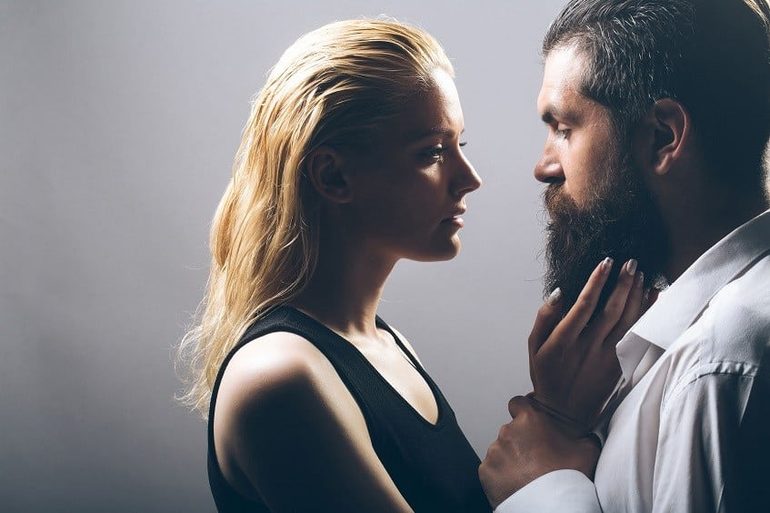 women touches man's beard
