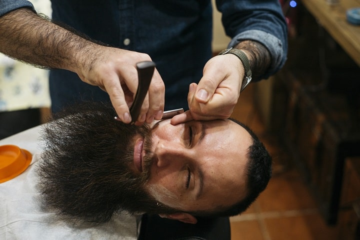 Pros and Cons of Trimming Your Beard at Barber's